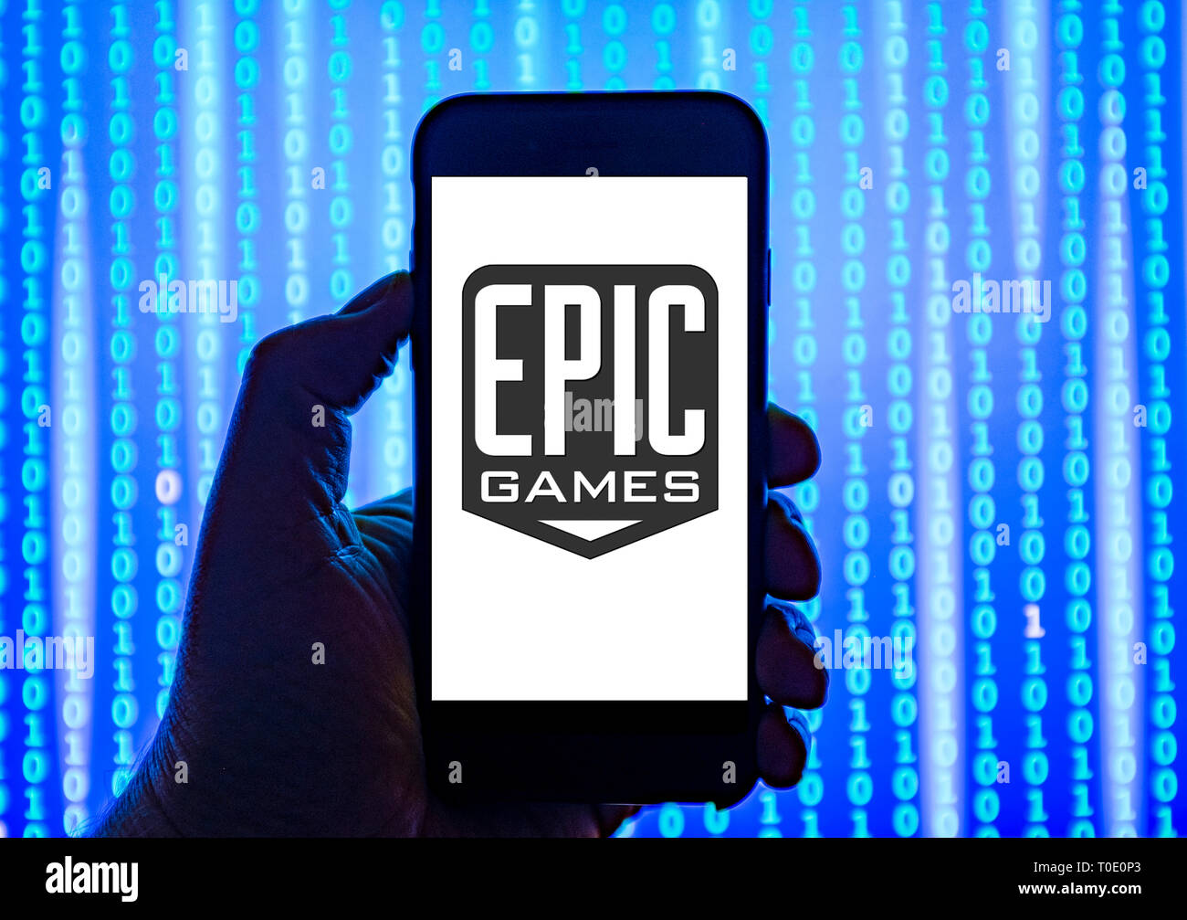 Person holding smart phone with Epic Games logo displayed on the