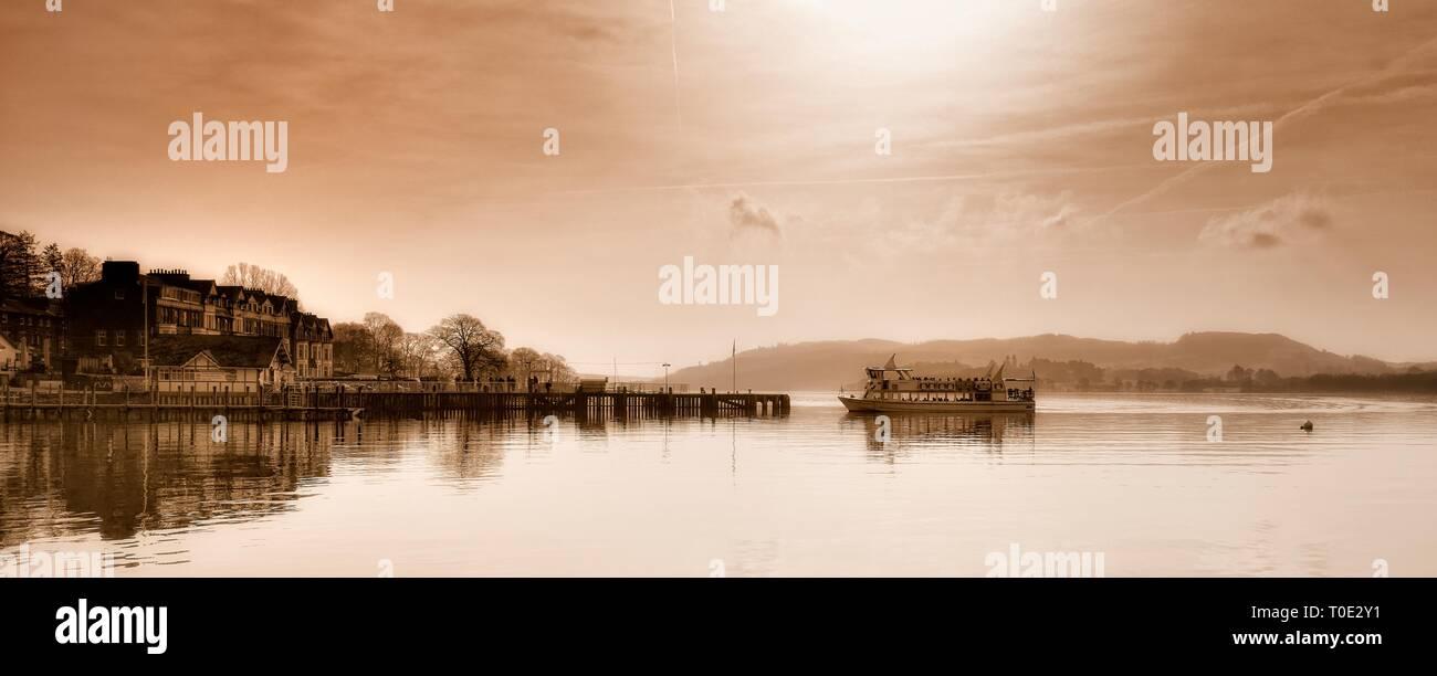 Boat arriving at,Waterhead,Ambleside,Lake Windermere,Lake District,Cumbria,England,UK - Stock Image