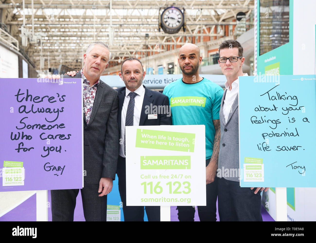 EDITORIAL USE ONLY (Left to right) Ian Stevens MBE, Suicide Prevention Programme Manager Network Rail, Andy Thomas, Network Rail Wessex Route Managing Director for Network Rail, ex-Premier League footballer, Leon McKenzie and Paul McDonald, Executive Director of External Affairs at Samaritans, attend the launch of the new Samaritans ???Real People, Real Stories??? campaign, which is supported by National Rail at London Waterloo station. - Stock Image