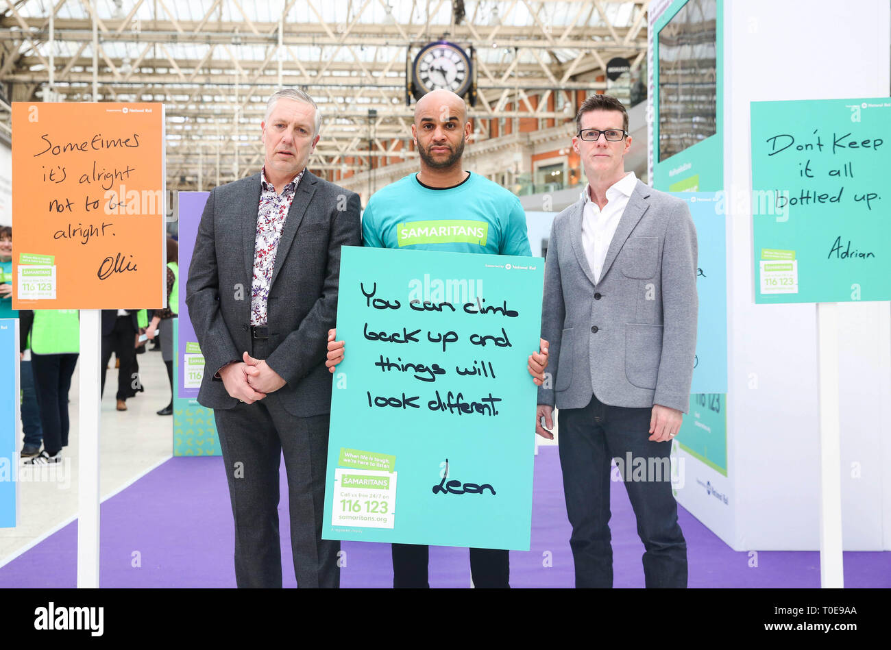 EDITORIAL USE ONLY (Left to right) Ian Stevens MBE, Suicide Prevention Programme Manager Network Rail, ex-Premier League footballer, Leon McKenzie and Paul McDonald, Executive Director of External Affairs at Samaritans, attend the launch of the new Samaritans ???Real People, Real Stories??? campaign, which is supported by National Rail at London Waterloo station. - Stock Image