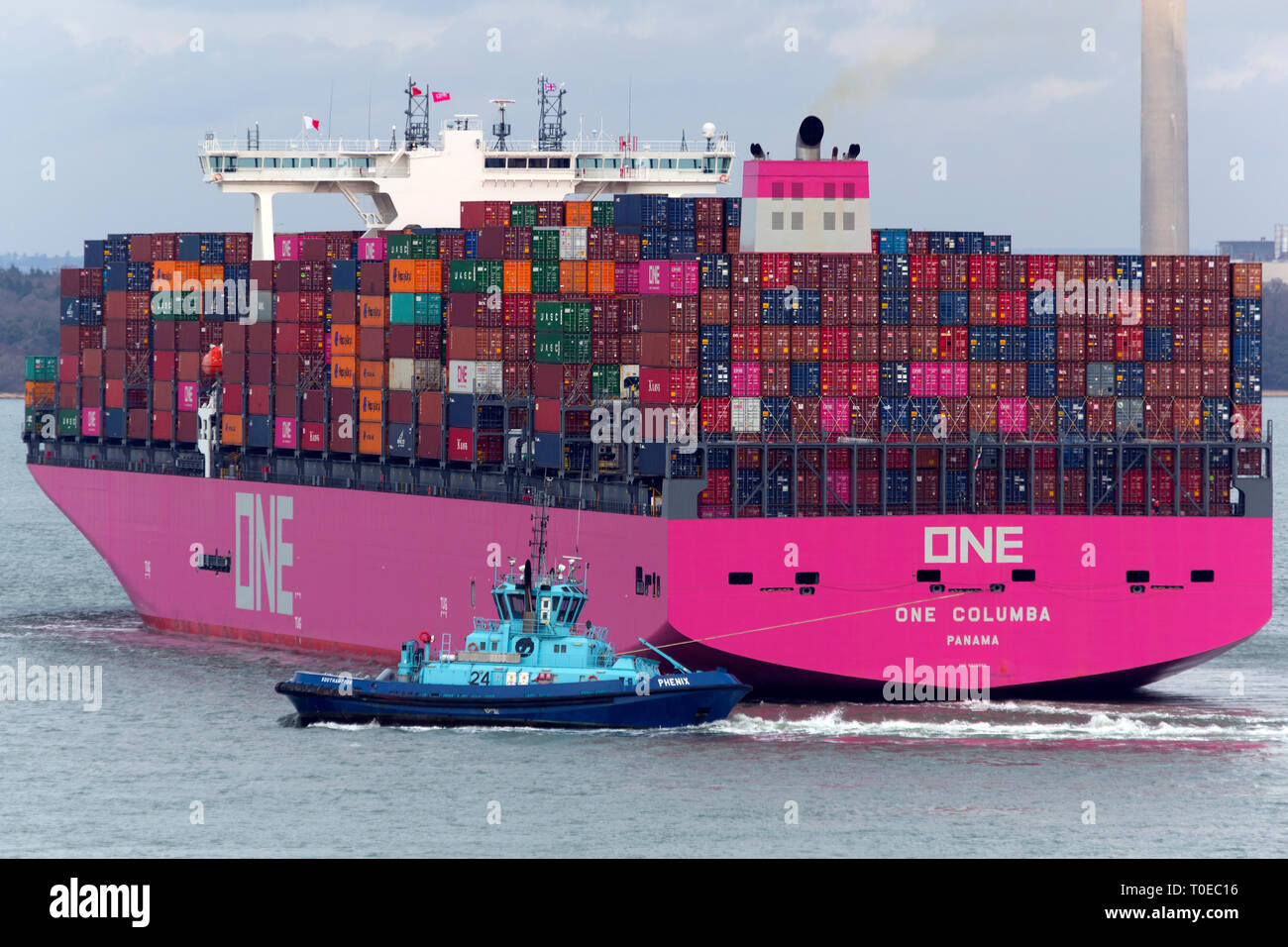 Pink,Ship, One Columbia, Panama, The Solent, heading, Southampton, Container Terminal, Cowes, Isle of Wight, Hampshire, England, UK.busy - Stock Image