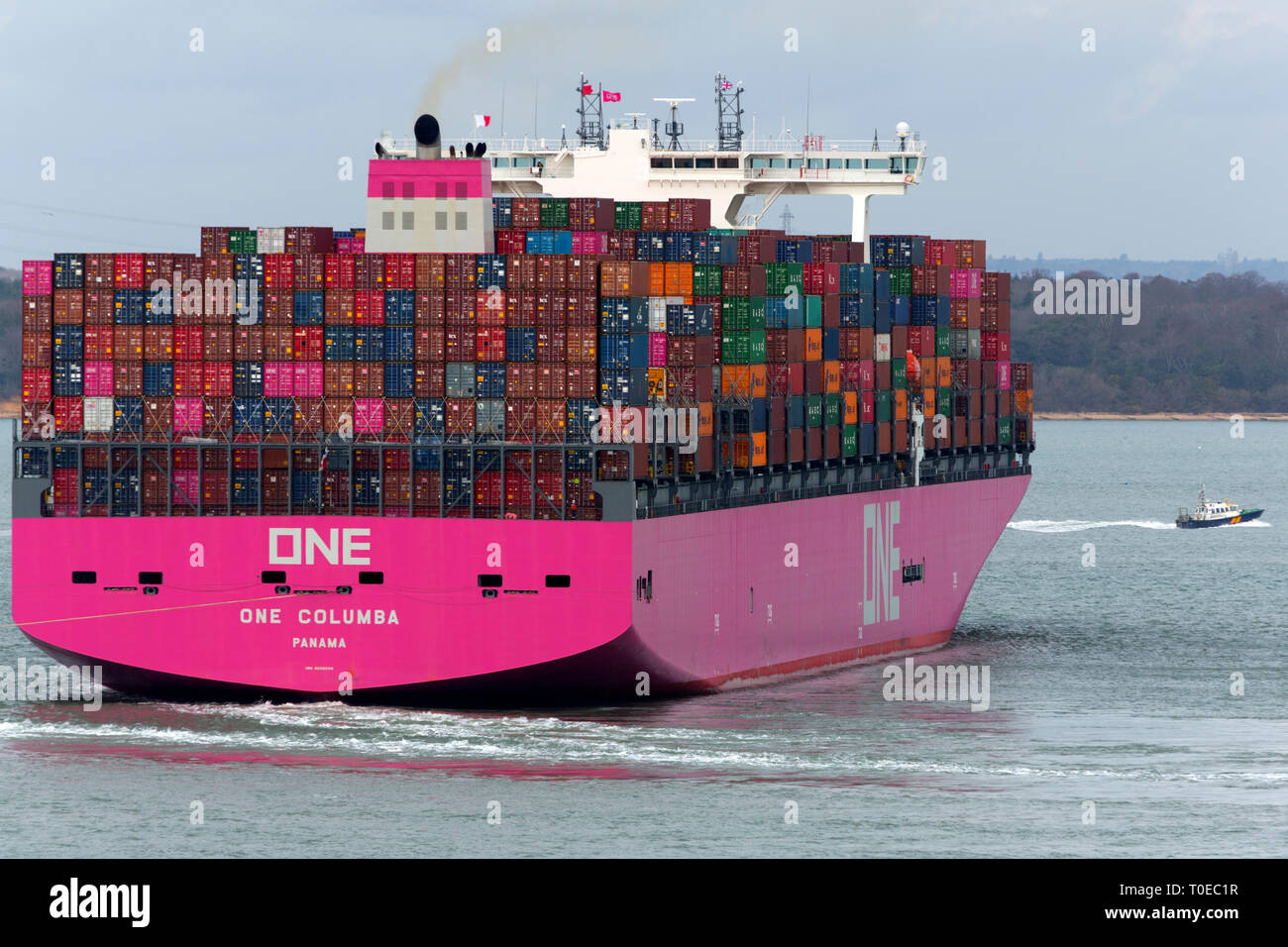 Pink,Ship, One Columbia, Panama, The Solent, heading, Southampton, Container Terminal, Cowes, Isle of Wight, Hampshire, England, UK Stock Photo