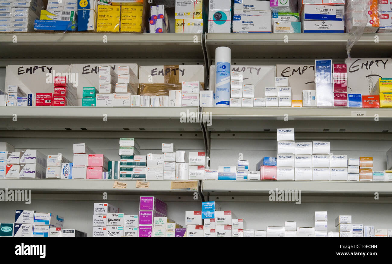 Various medications and drugs on chemist shelves in a pharmacy. - Stock Image