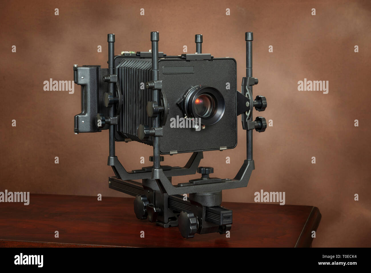 Horizontal shot of a 4x5 View Camera On Brown With Copy Space - Stock Image