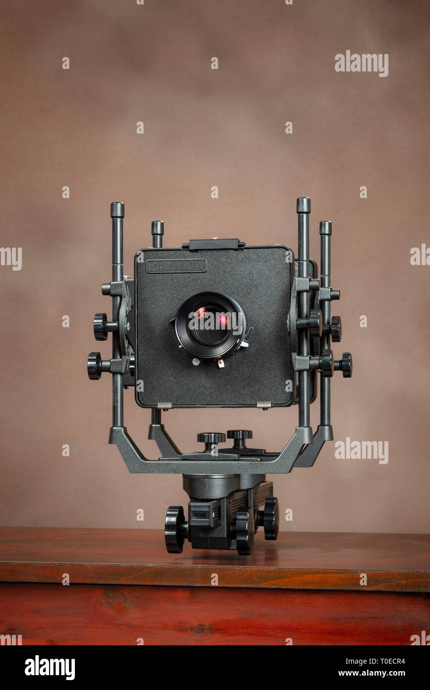 Vertical shot of a Large Professional View Camera On Brown With Copy Space. - Stock Image
