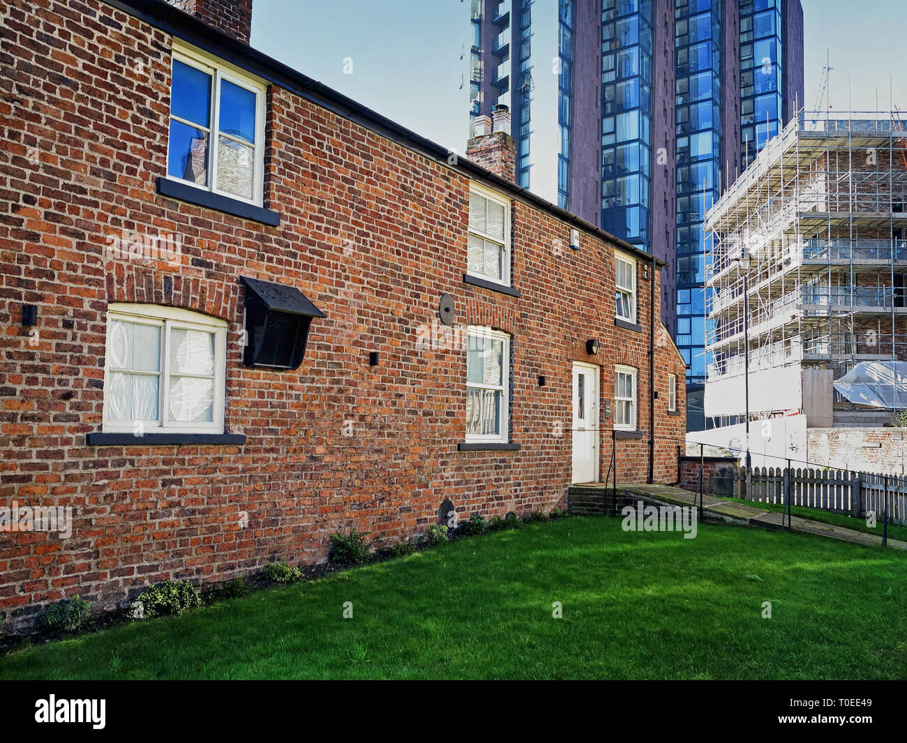 Stages of development by Canal Cottage on the Ashton Canal, Ancoats, Manchester - Stock Image