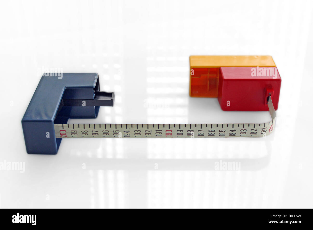 Vintage arty Mondrian style measuring tape meter, isolated on white background - Stock Image