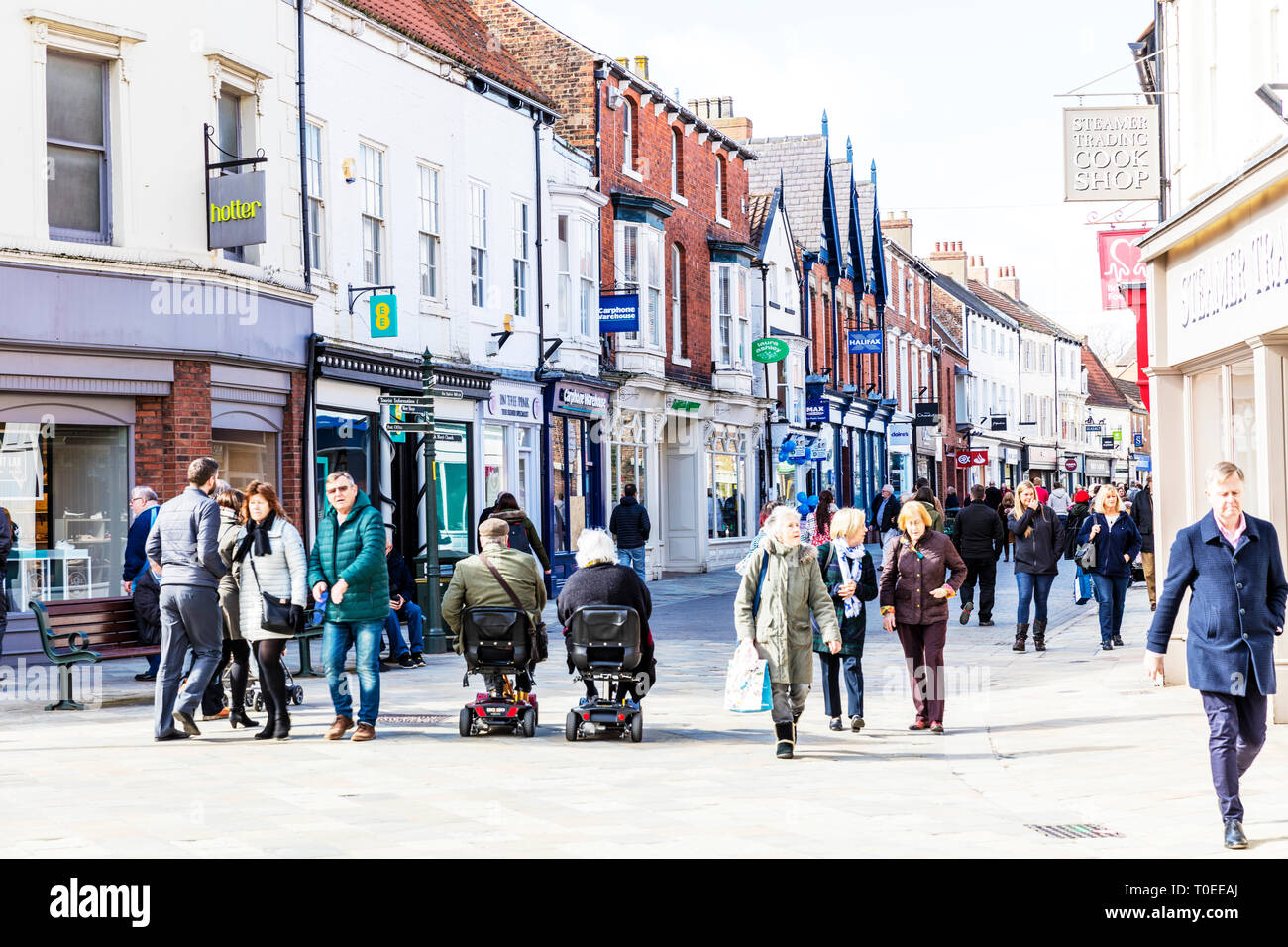 Beverley town centre, Beverley high street, center, shops, shoppers, stores outside main street shopping area Beverley Yorkshire UK England Stock Photo