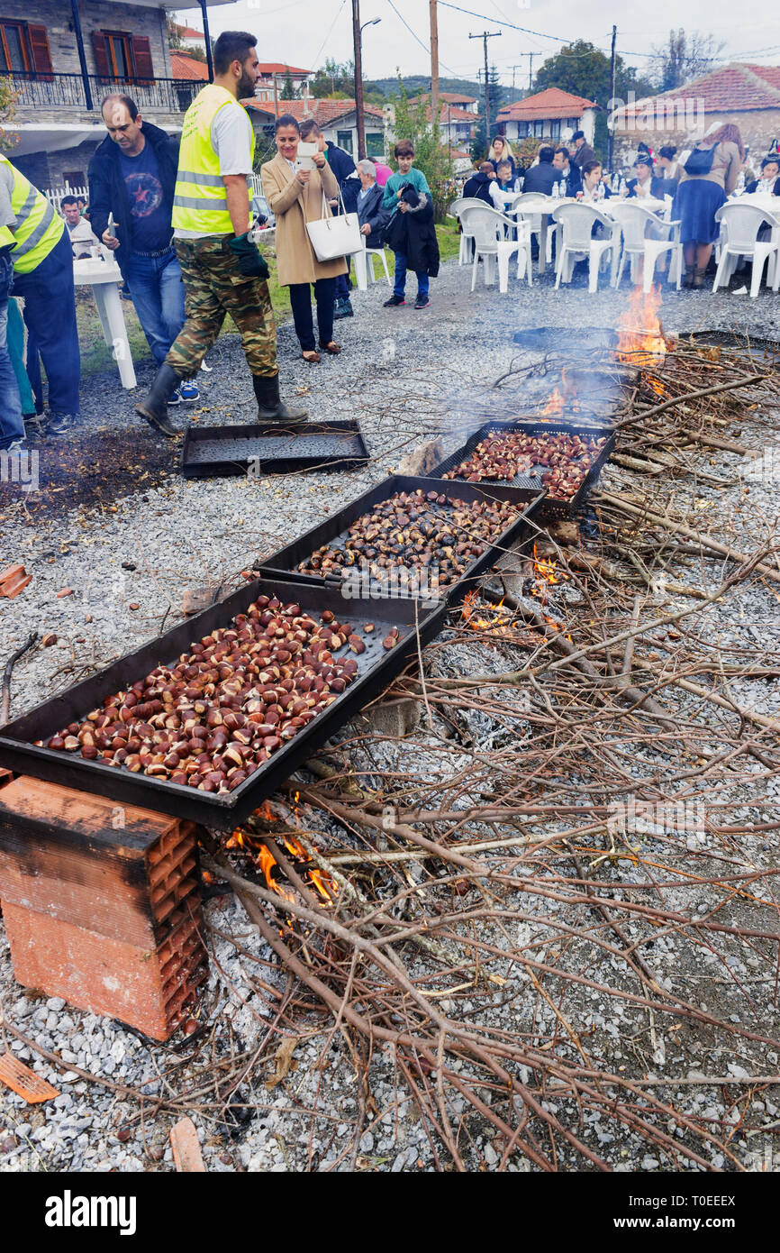 Row of chestnut roasting on an open fire in Leivadi or Livadi village, Thessalonica, Greece - Stock Image