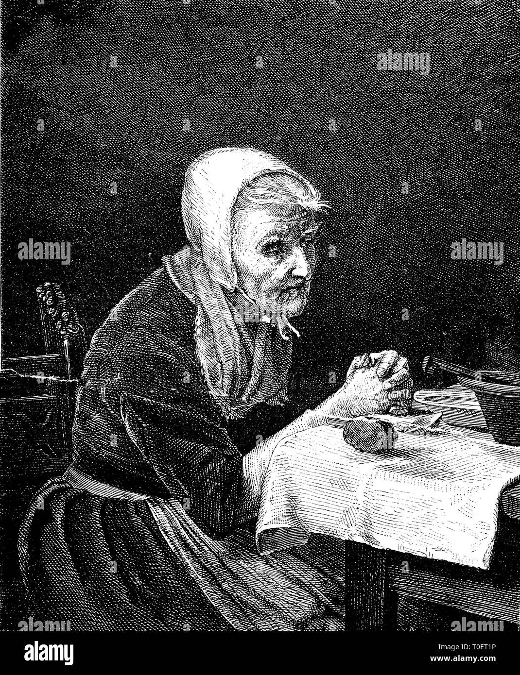 the frugal, old woman with a spare time at the table prayer  /   Genügsame, alte Frau mit einem kargen Mahl beim Tischgebet Stock Photo
