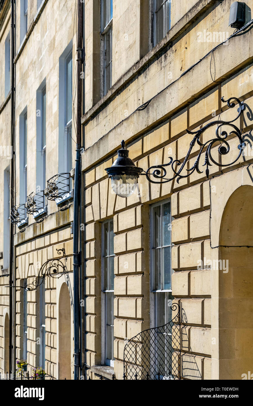 Part of the facade of Marlborough Buildings, Bath, England with a wrought iron lamp bracket - Stock Image