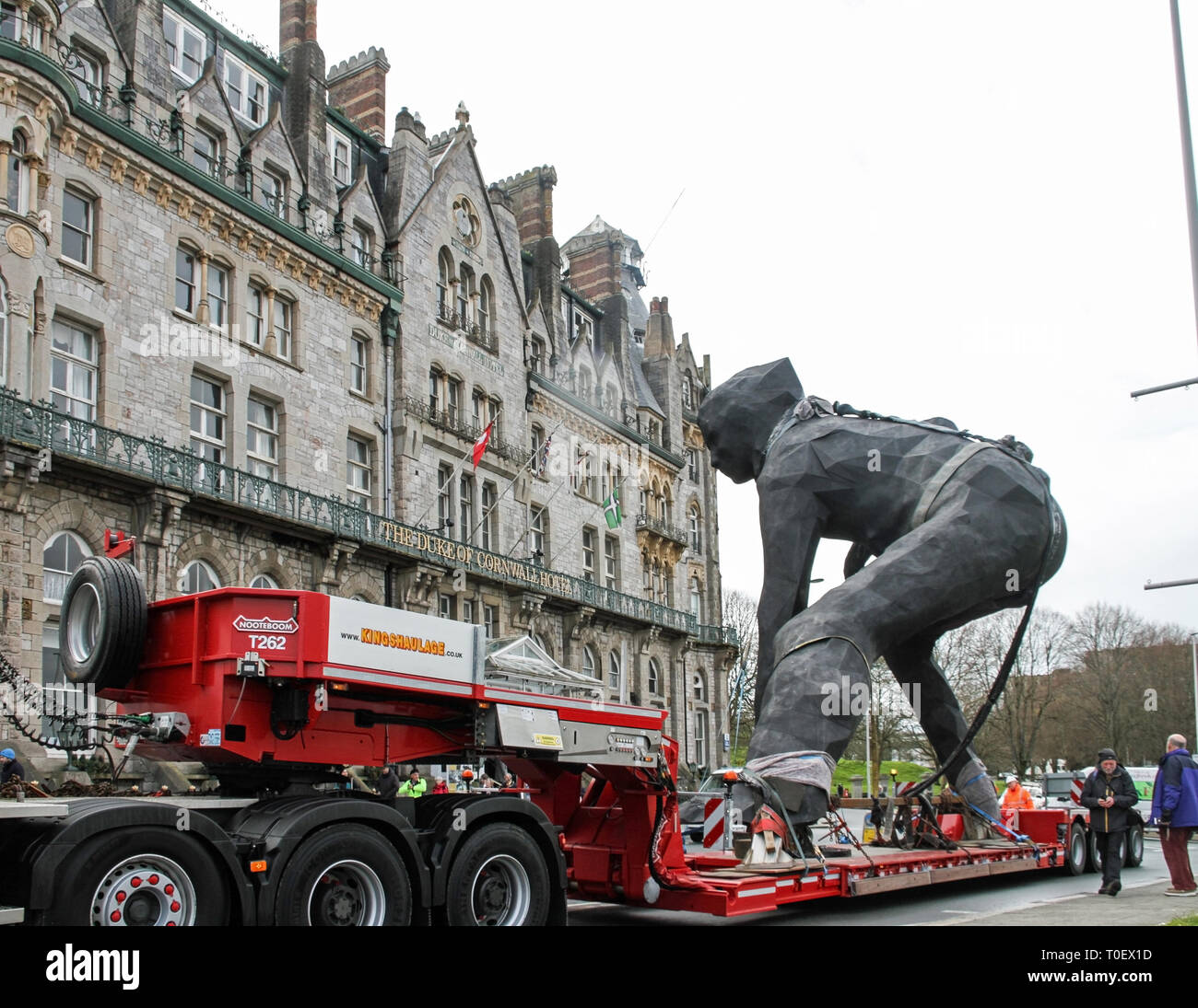 The largest cast bronze sculpture in the UK, The Messenger, paraded through Plymouth on route to her home outside the Theatre Royal Plymouth. The Crea Stock Photo