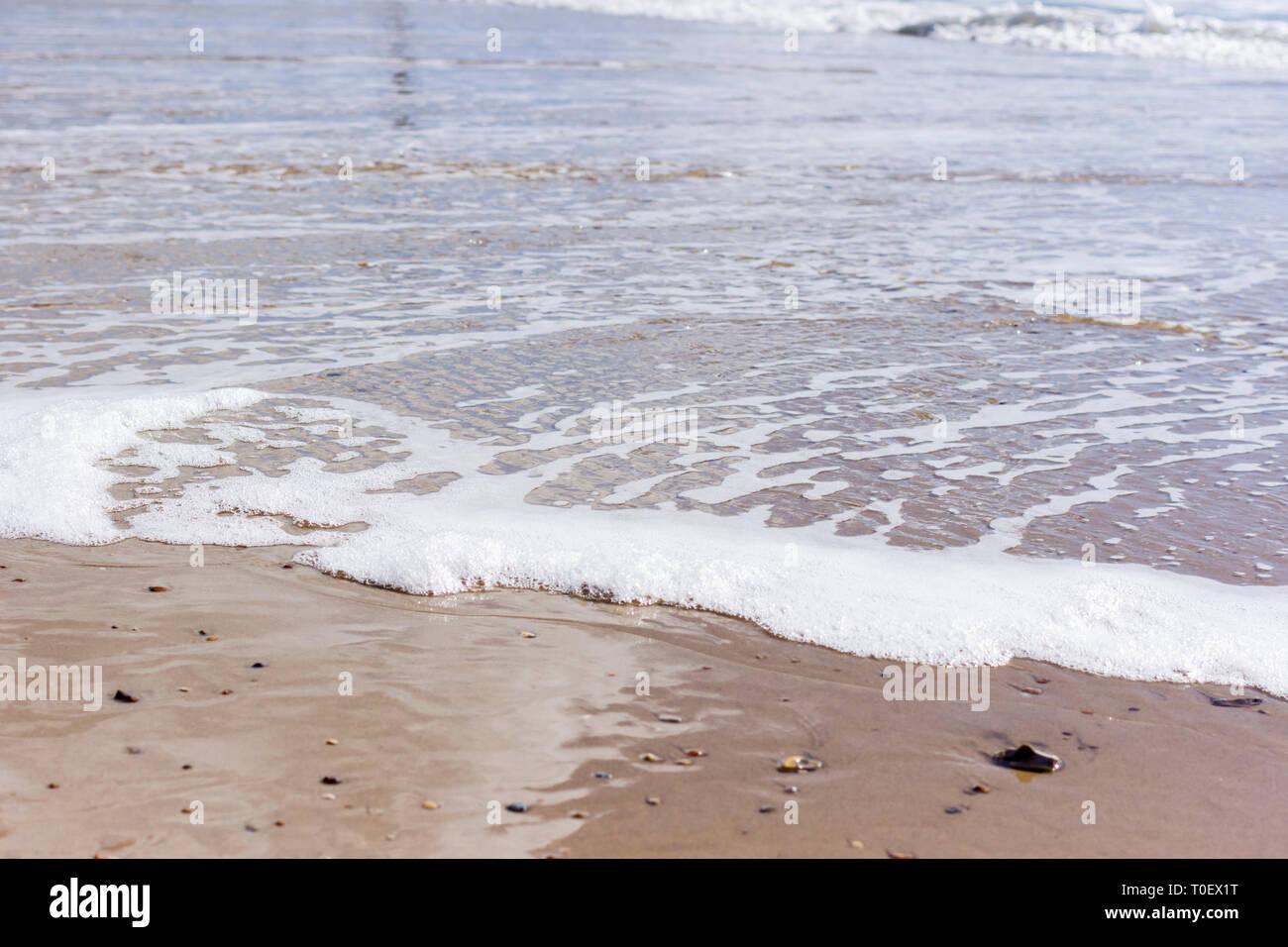Waves lapping onto the beach, Bournemouth, Dorset, UK - Stock Image