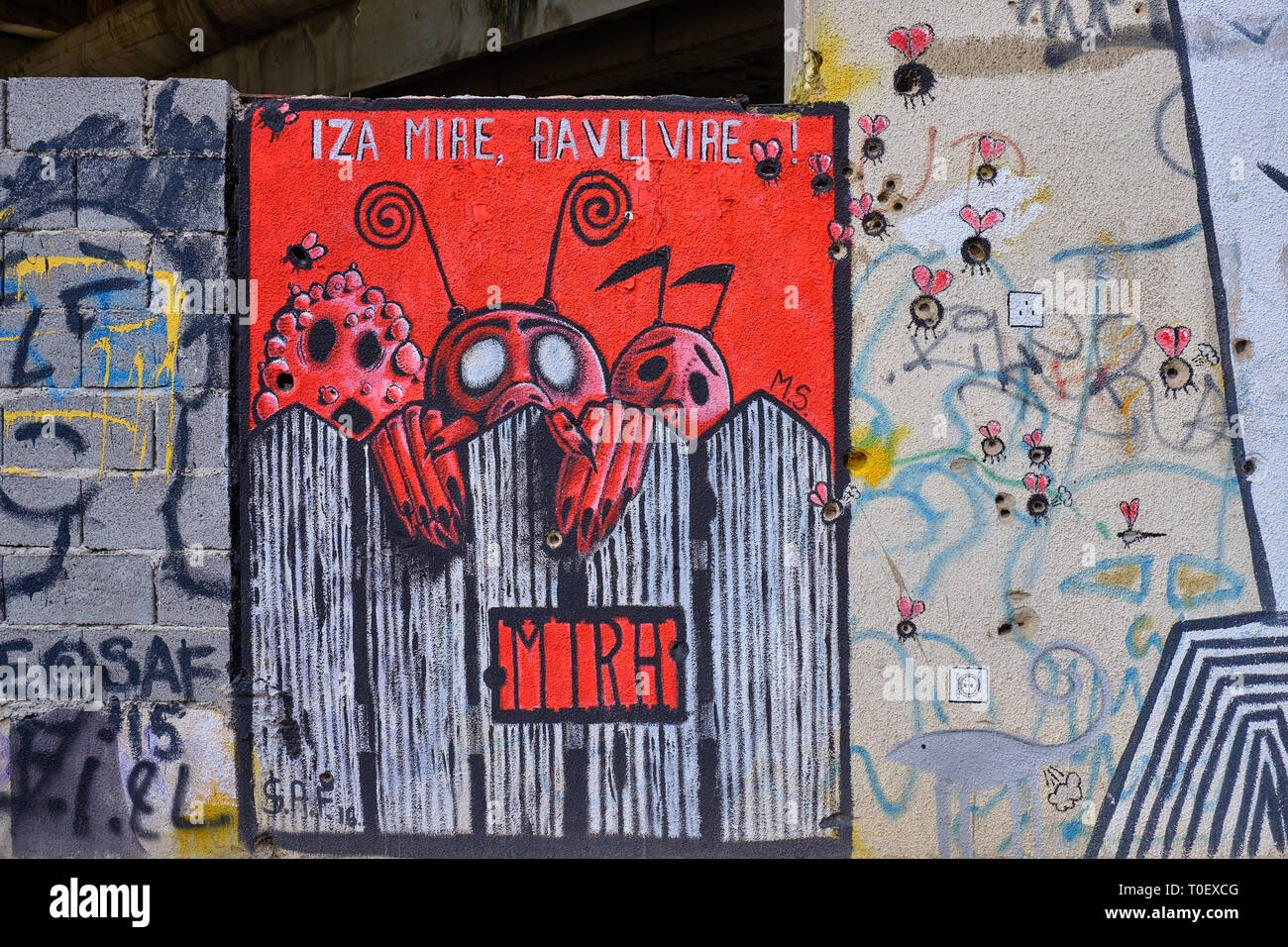 Wall art in Mostar, where the painter used bullet and shrapnel holes as part of design.  Bullet holes used as body of bugs Stock Photo