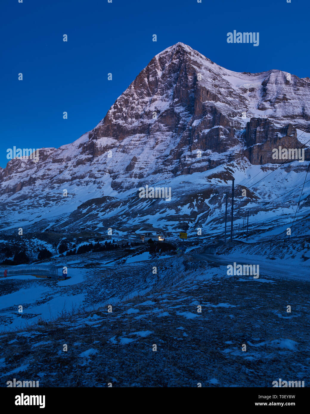 Unplugged in the Jungfrau region. An unusual moonlit view of the Eiger's North Face during the evening blue hour. - Stock Image