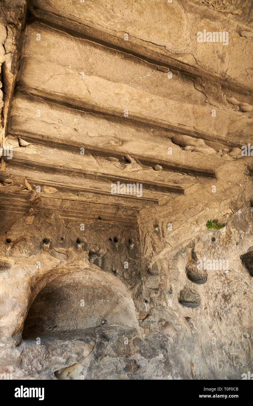 Picture & image of rock hall interiors with decorated ceilings Uplistsikhe (Lords Fortress) troglodyte cave city, near Gori, Shida Kartli, Georgia. UN - Stock Image