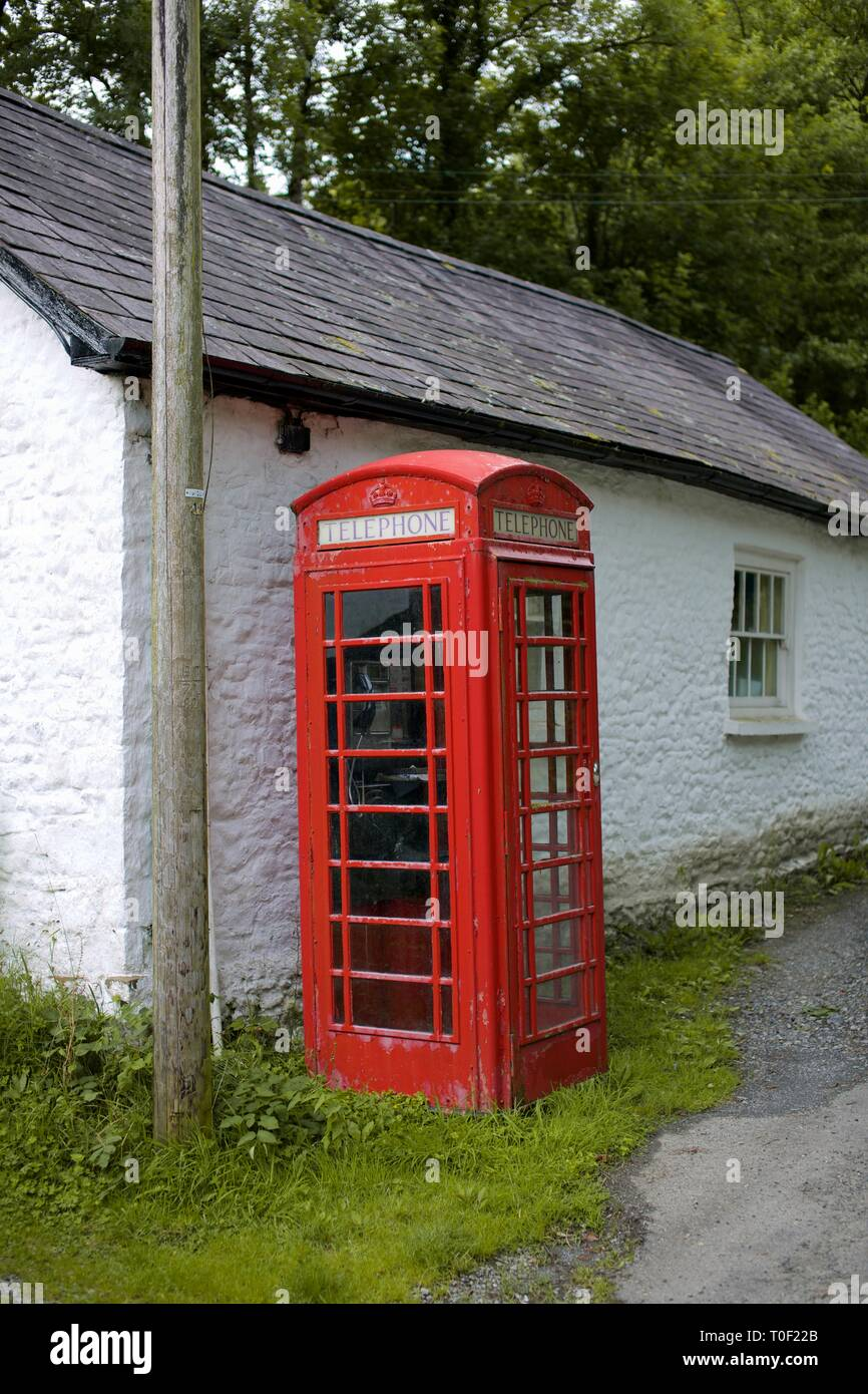 Traditional Red UK Phone Box in a small village in Cwmdu, Carmarthenshire, Wales - Stock Image