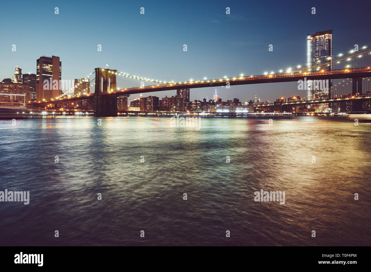 Brooklyn Bridge at blue hour, color toned picture, New York City, USA. - Stock Image