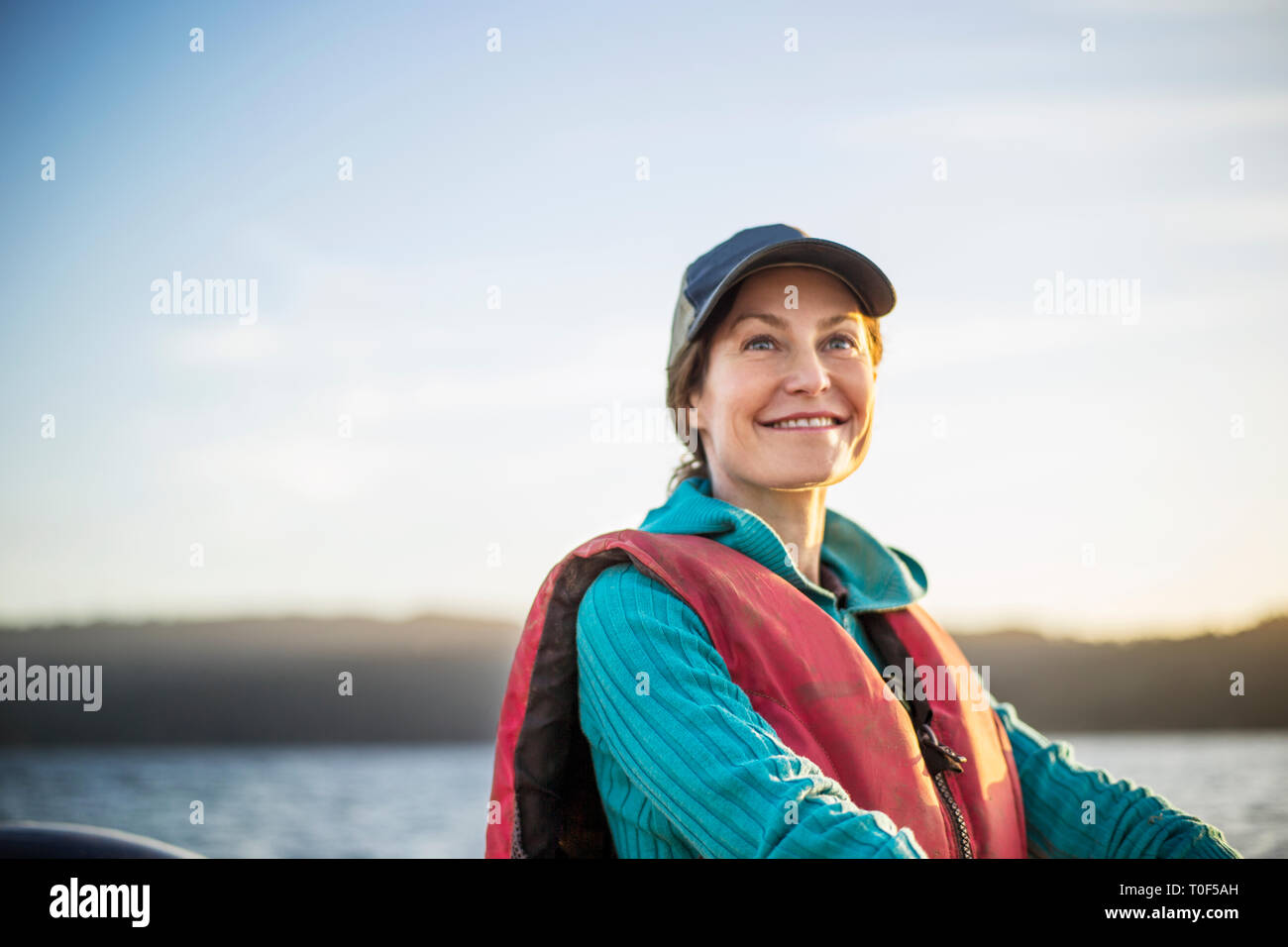 Smiling mid adult woman on boat. Stock Photo