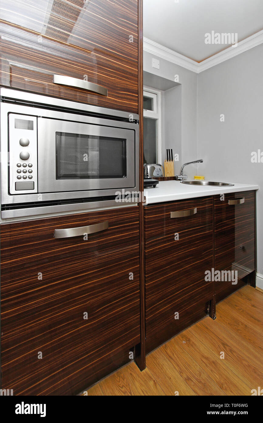 Built In Microwave Oven In Small Kitchenette Stock Photo Alamy