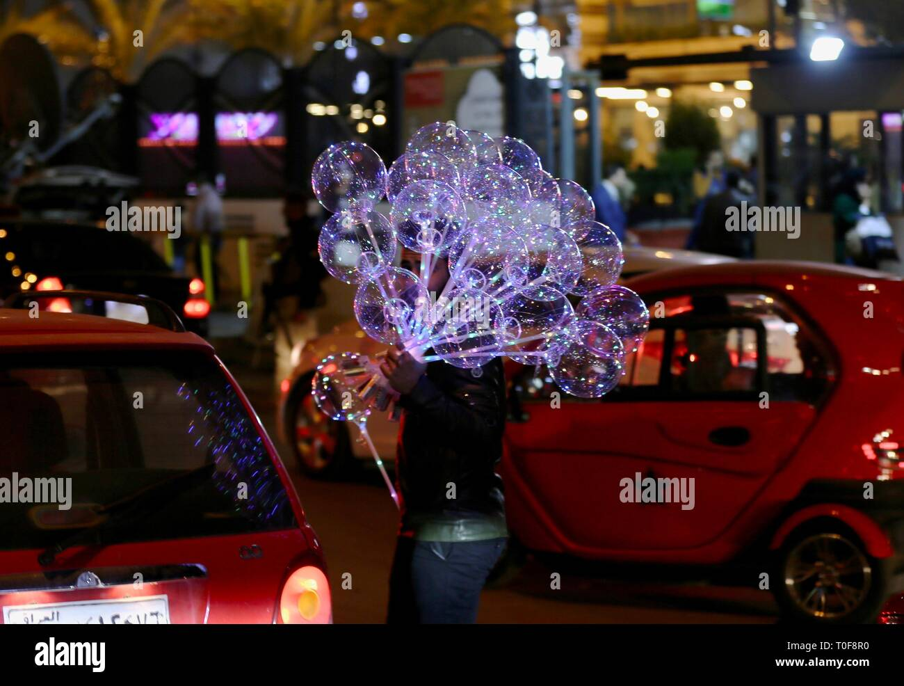Baghdad, Iraq. 19th Mar, 2019. A boy sells balloons at night in Baghdad, Iraq, Dec. 10, 2018. (TO GO WITH Feature: Rising hopes, opportunities 16 years after U.S.-led invasion in Iraq, released on March 19, 2019) Credit: Xinhua/Alamy Live News Stock Photo