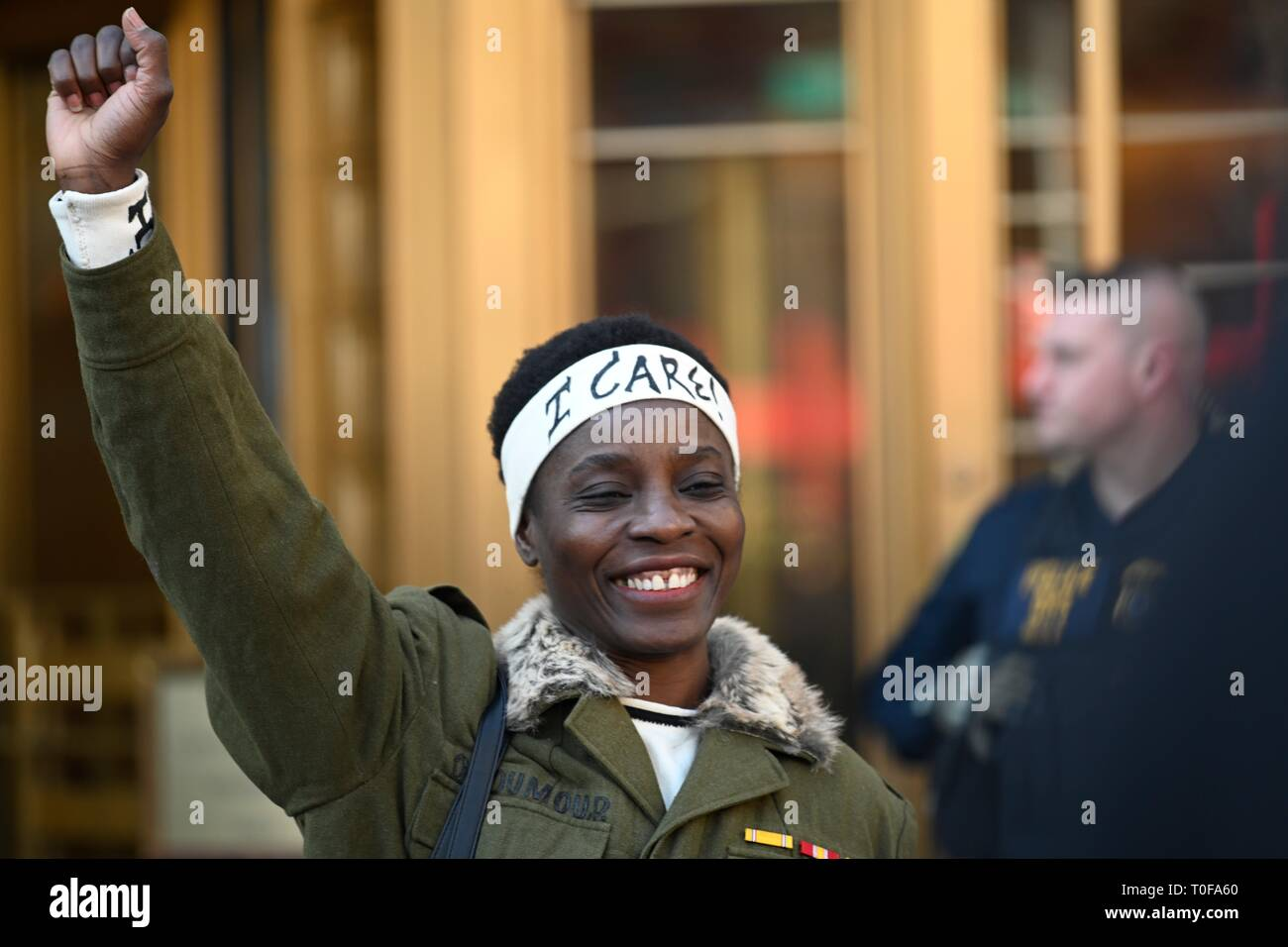 New York, NY, USA. 19 March 2019  State of Liberty climber Patricia Okoumou smiles while leaving court after being sentenced to 5 years of probation for her July 4, 2018, act of civil disobedience to protest against Trump administration immigration policies.  Okoumou was convicted in December of misdemeanor charges of trespassing, disorderly conduct, and interfering with the functioning of government. Credit: Joseph Reid/Alamy Live News - Stock Image