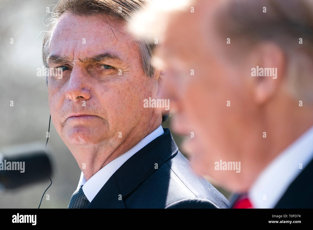 US President Donald J. Trump (R) and Brazilian President Jair Bolsonaro (L) speak at a press conference in the Rose Garden of the White House in Washington, DC, USA, 19 March 2019. Bolsonaro, a right-wing nationalist, earned the nickname the 'Trump of the Tropics.' Credit: Jim LoScalzo / Pool via CNP /MediaPunch - Stock Image