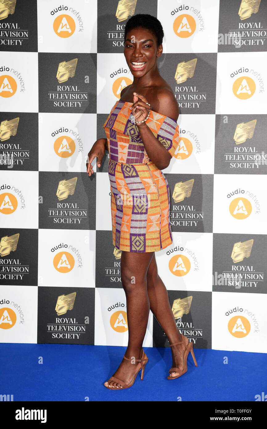 LONDON, UK. March 19, 2019: Michaela Coel arriving for the Royal Television Society Awards 2019 at the Grosvenor House Hotel, London. Picture: Steve Vas/Featureflash Credit: Paul Smith/Alamy Live News Stock Photo