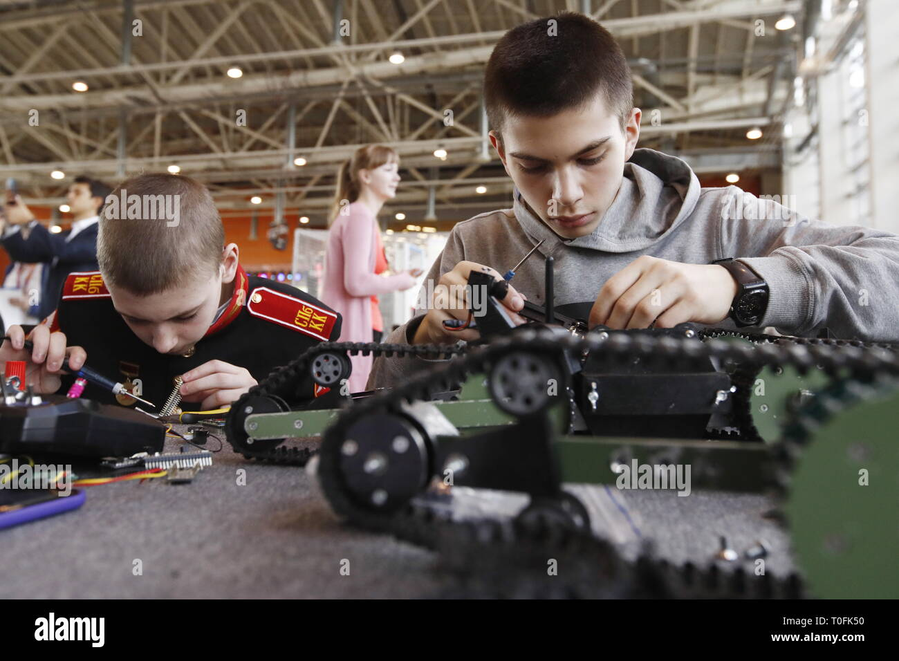 EDITORIAL USE ONLY; NO COMMERCIAL USE; NO ADVERTISING    MOSCOW, RUSSIA - MARCH 20, 2019: Children attend a robotics class as part of the PROFEST 2019 technology festival for people aged from 6 to 30 at the VDNKh exhibition centre. Artyom Geodakyan/TASS Stock Photo