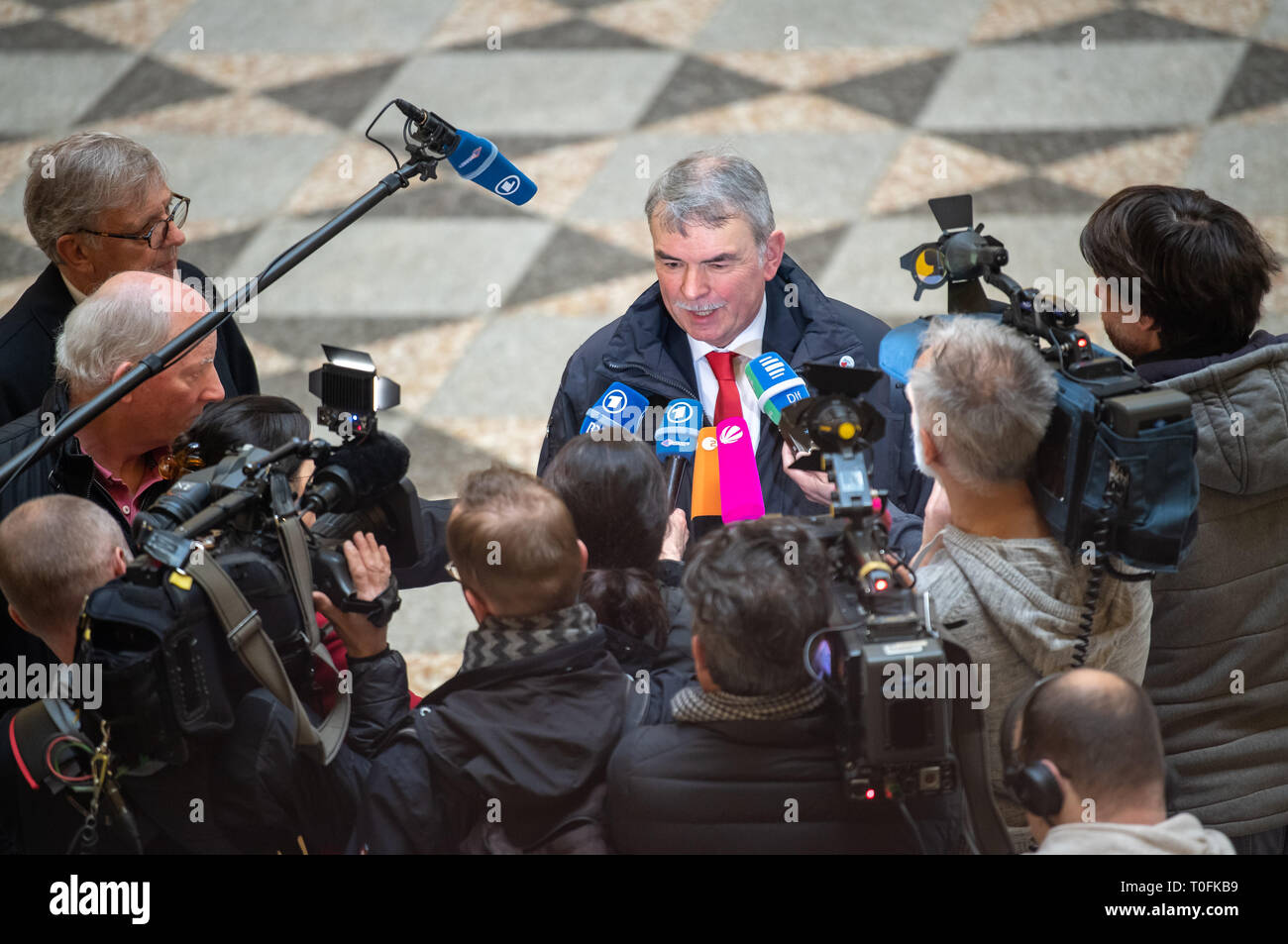 20 March 2019, Bavaria, München: The plaintiff Gustl Mollath talks to the journalists present before the trial begins. In the trial, Mollath demands about 1.8 million euros from the Free State of Bavaria for his unjustified placement in a psychiatric institution. Photo: Peter Kneffel/dpa - Stock Image