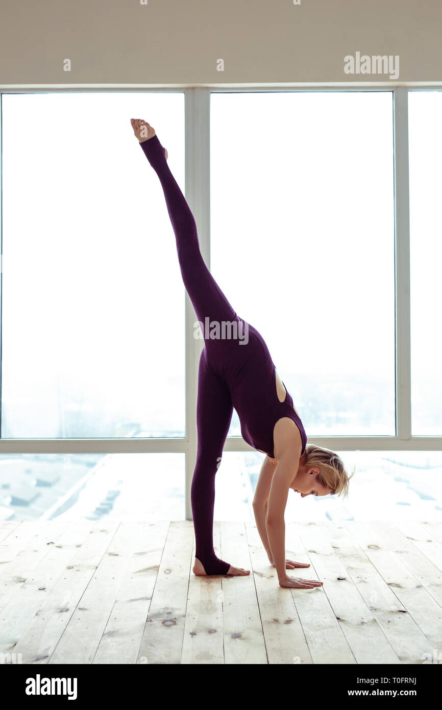 Flexible focused young lady showing her great skills - Stock Image