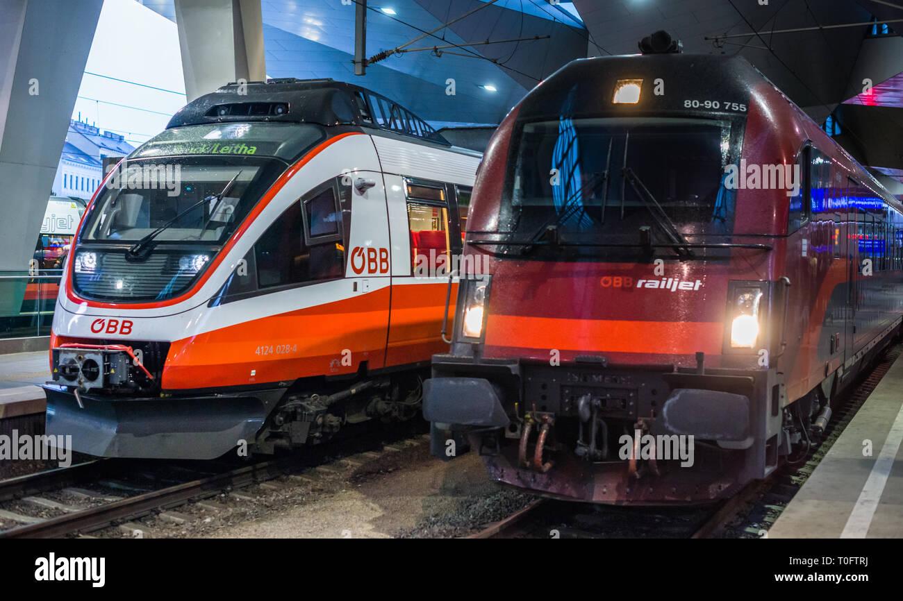 ÖBB Talent railcar next to the airport train Railjet at Vienna Central station Hauptbanhauf, Austria. - Stock Image