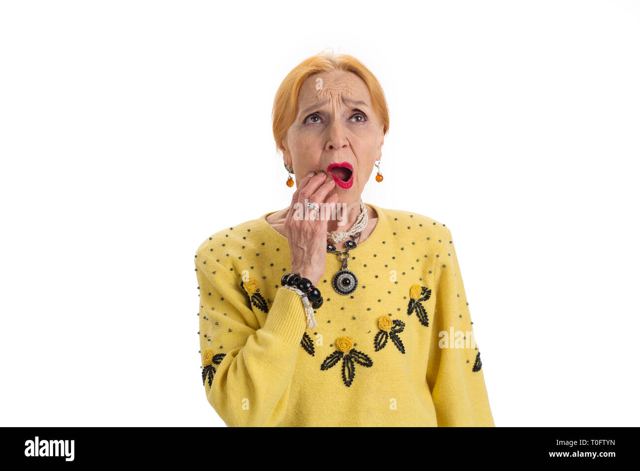 Senior woman having toothache  Upset lady touching her cheek