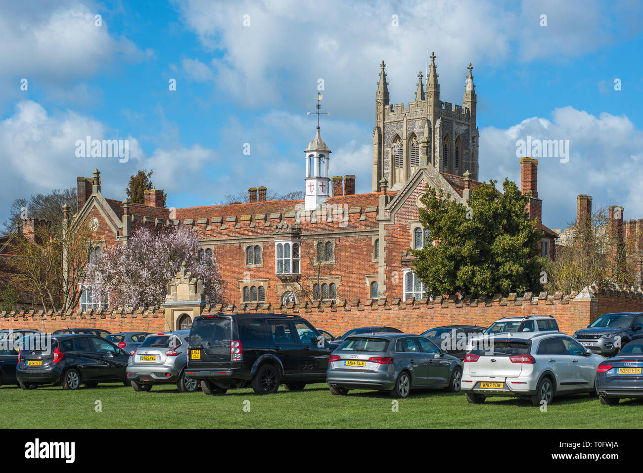 Hospital of the Holy and Blessed Trinity with Holy Trinity Church to the rear, in the village of Long Melford, Suffolk, East Anglia, UK. - Stock Image