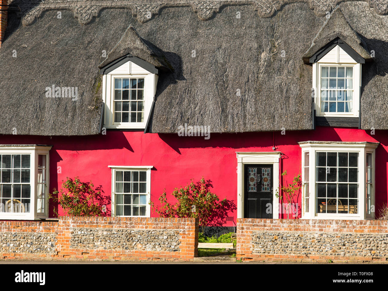 Pictureque red thatched cottage at Cavendish village in Suffolk, East Anglia, England, UK. - Stock Image
