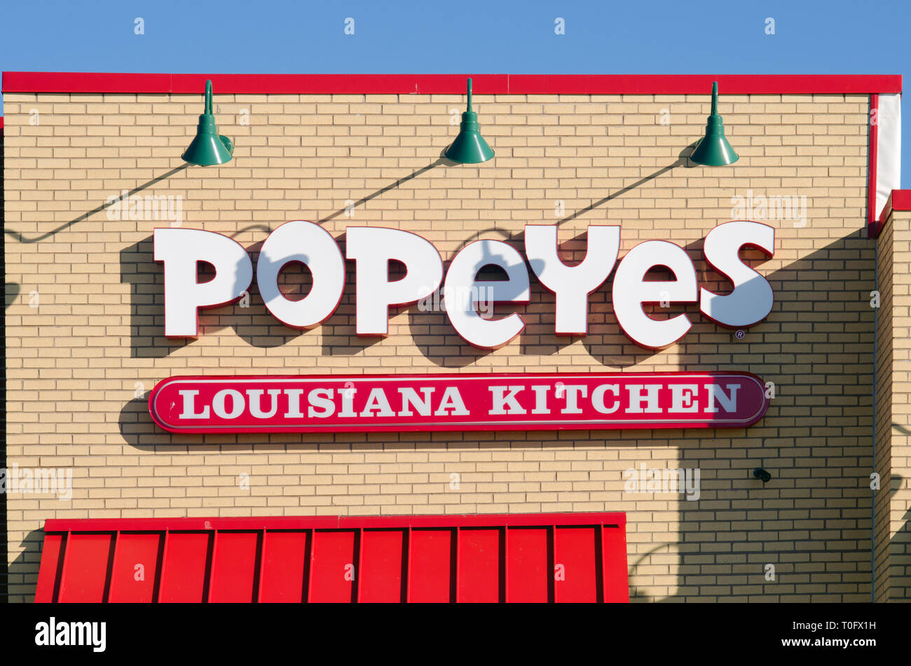 Exterior of Popeyes Louisiana Kitchen restaurant with sign in New Bedford, Massachusetts USA. US chain is known for fried chicken - Stock Image