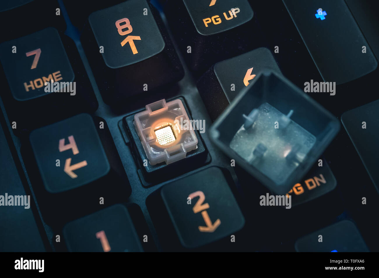 Romer-G backlit mechanical keyboard numerical buttons detail shot. - Stock Image