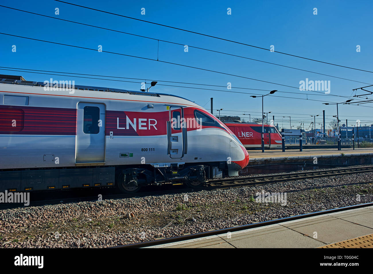 New Azuma streamlined trains in LNER railway livery at Peterborough station. Stock Photo