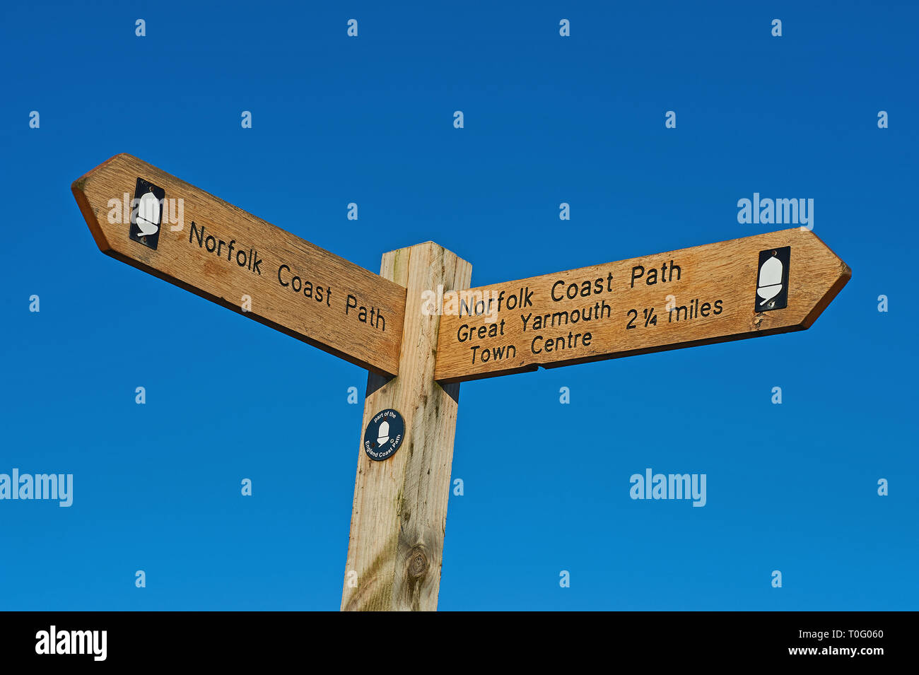 Wooden finger post sign against a blue sky Stock Photo