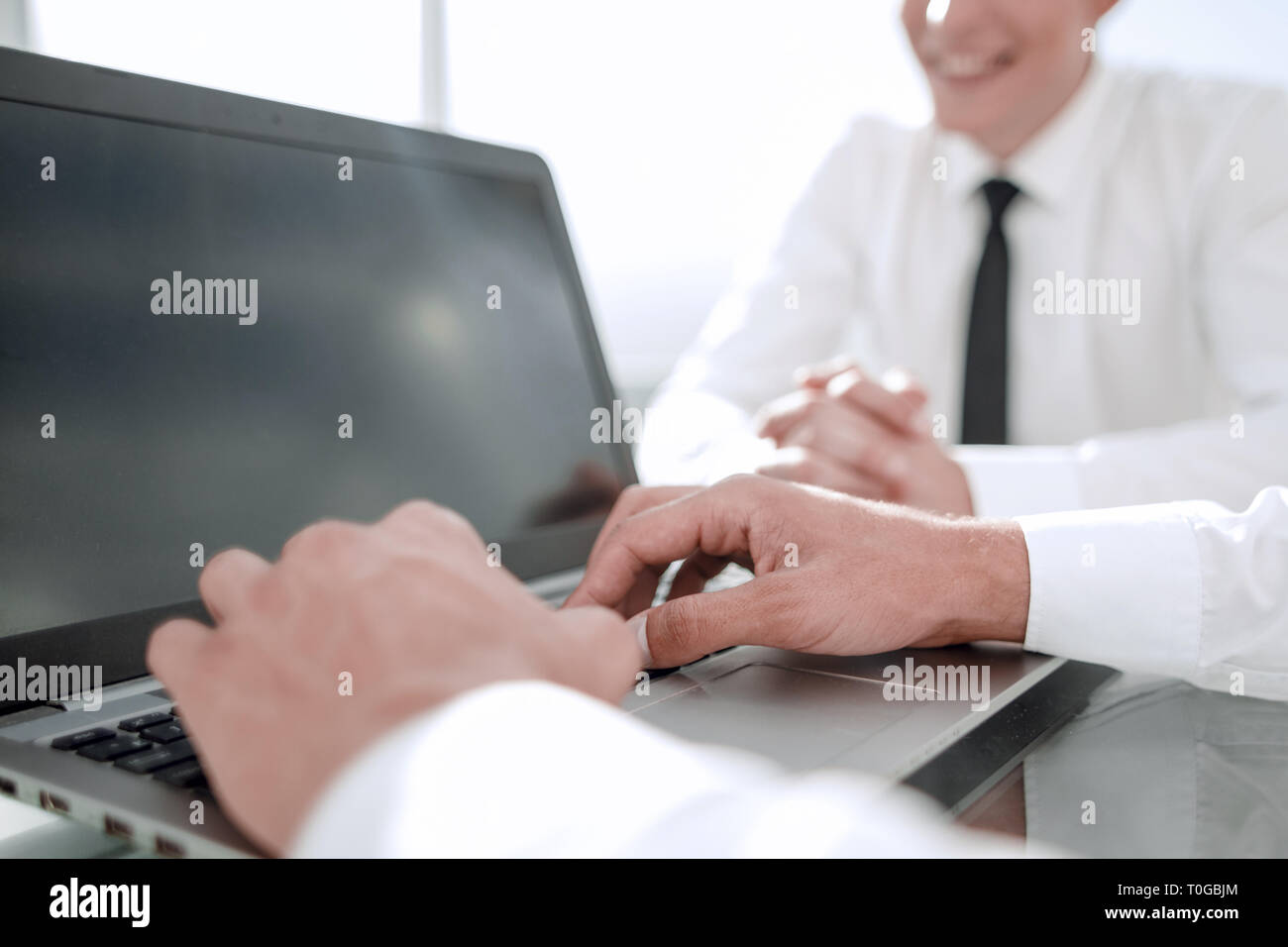close up.businessman dialing uses the laptop in the office - Stock Image