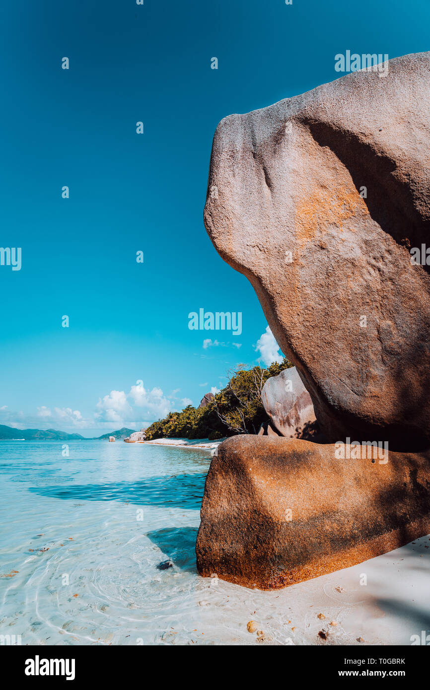 Huge beautifully shaped bizarre granite boulders in evening light at famous Anse Source d'Argent beach, La Digue island, Seychelles Stock Photo