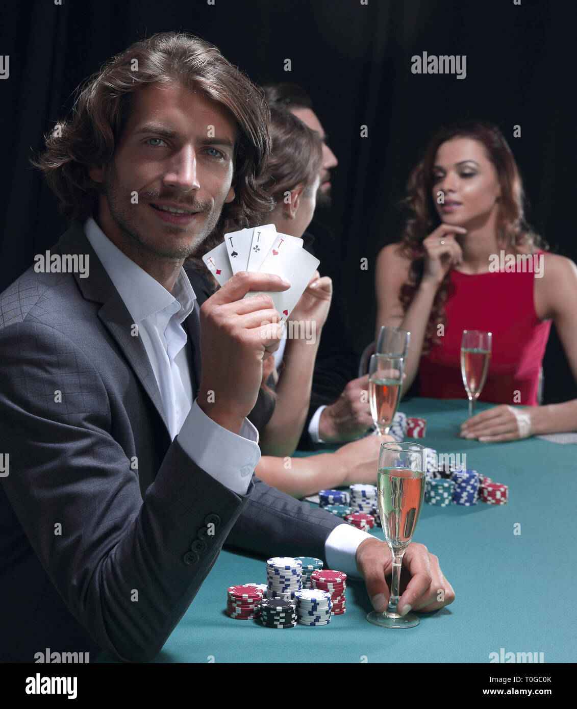 group of sinister poker players - Stock Image