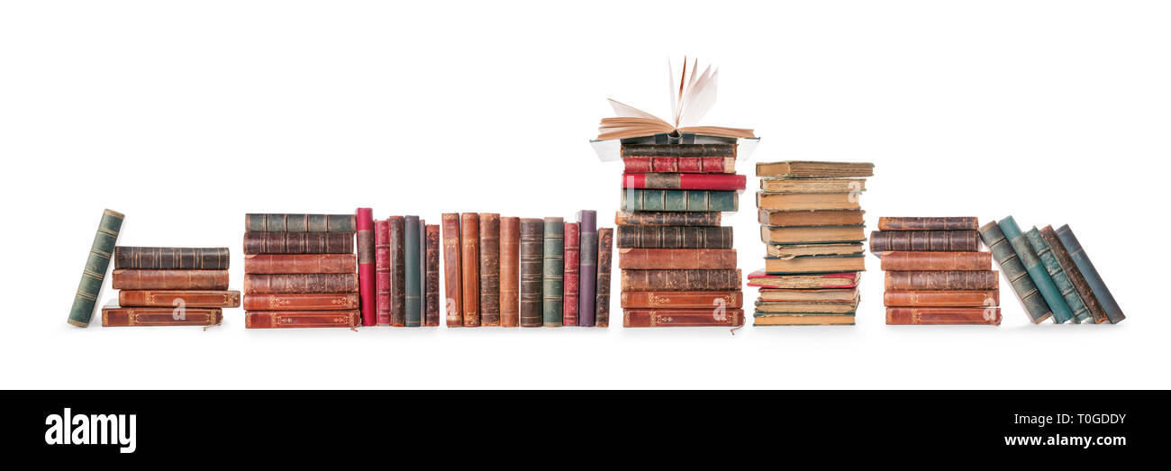 Long old books row isolated on white, clipping path included - Stock Image