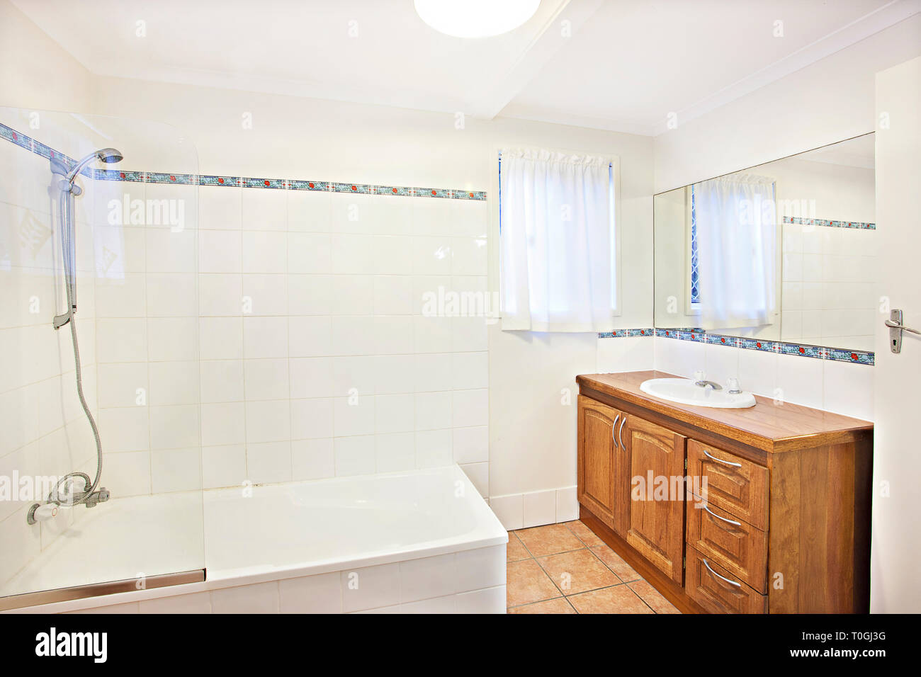 Small Bathroom With Fitted Shower Over The Bath Tub With ...