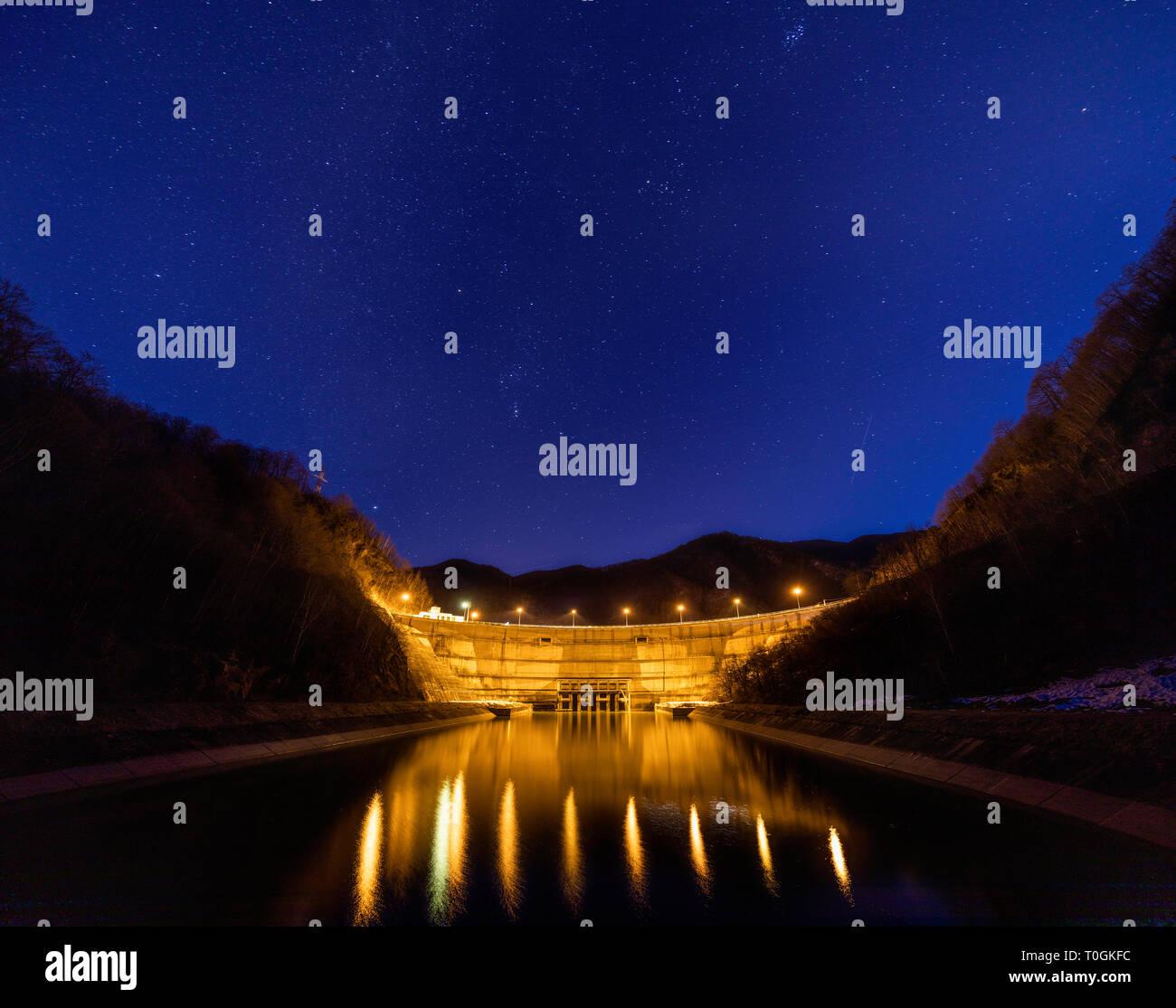 Dam lake under starry night sky Stock Photo: 241311712 - Alamy