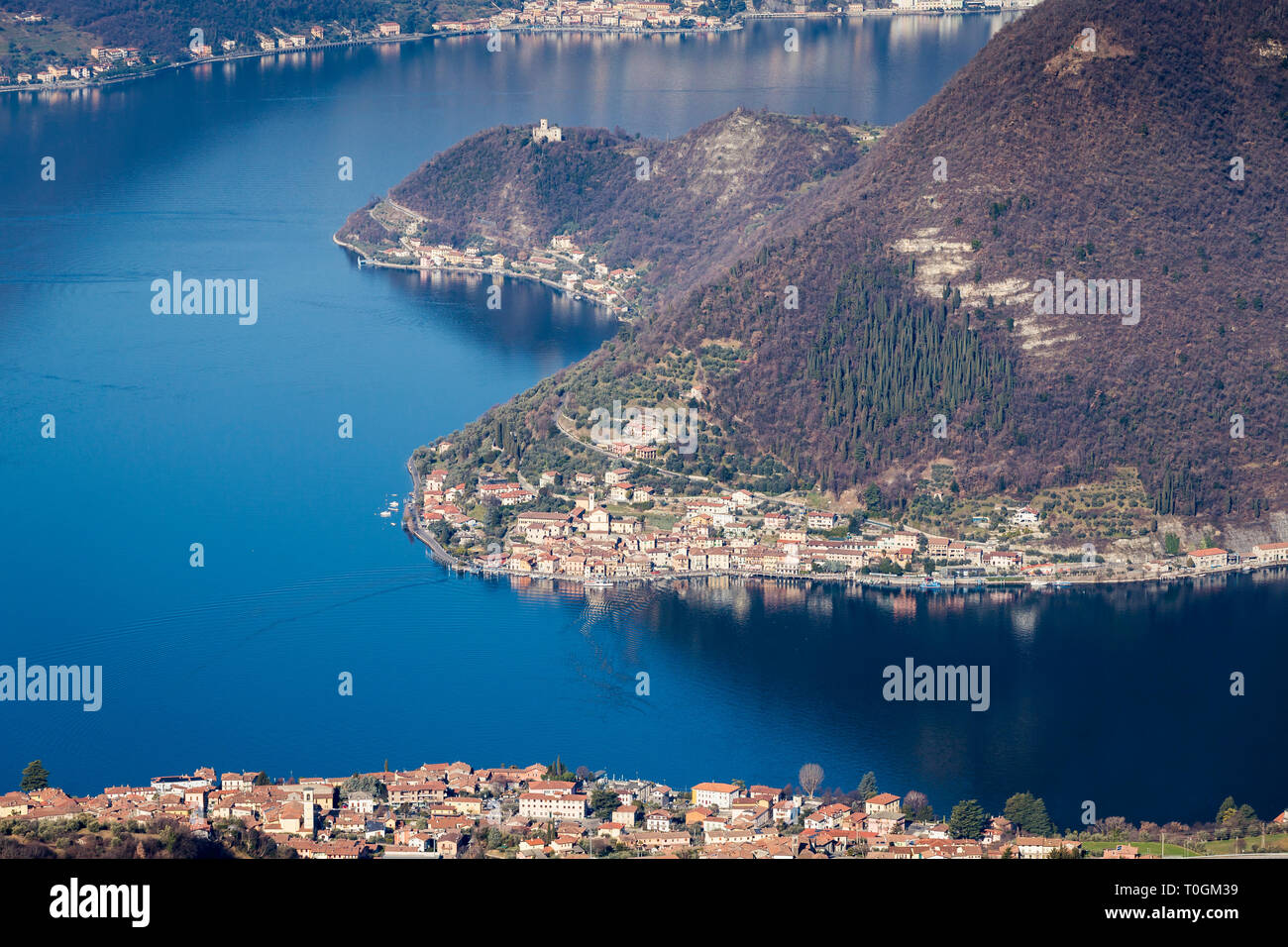 Lake Iseo with the village of Sulzano and Peschiera Maraglio on Monte Isola island, Lombardy, Italy - Stock Image