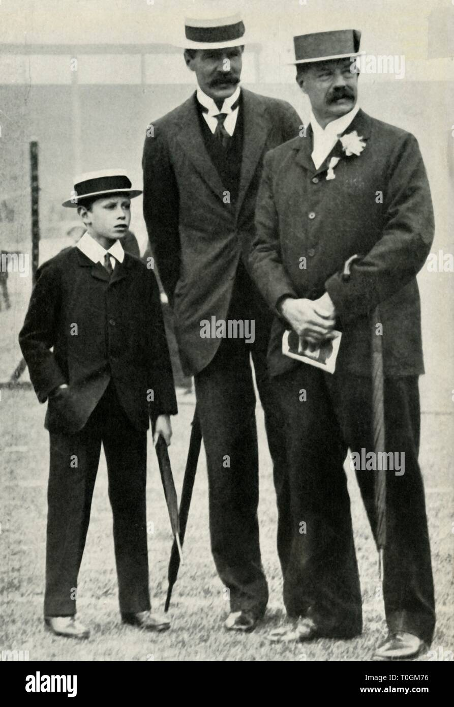 """Prince Albert with his tutor and Lord Desborough, 1908, (1947). Prince Albert, (the future King George VI 1895-1952), attending an athletics meeting aged 13, with his tutor Mr Henry Peter Hansell, and Lord Desborough, British athlete, sportsman and politician. From """"The Saturday Book"""", Seventh Year, edited by Leonard Russell. [Hutchinson, St. Albans, 1947] - Stock Image"""