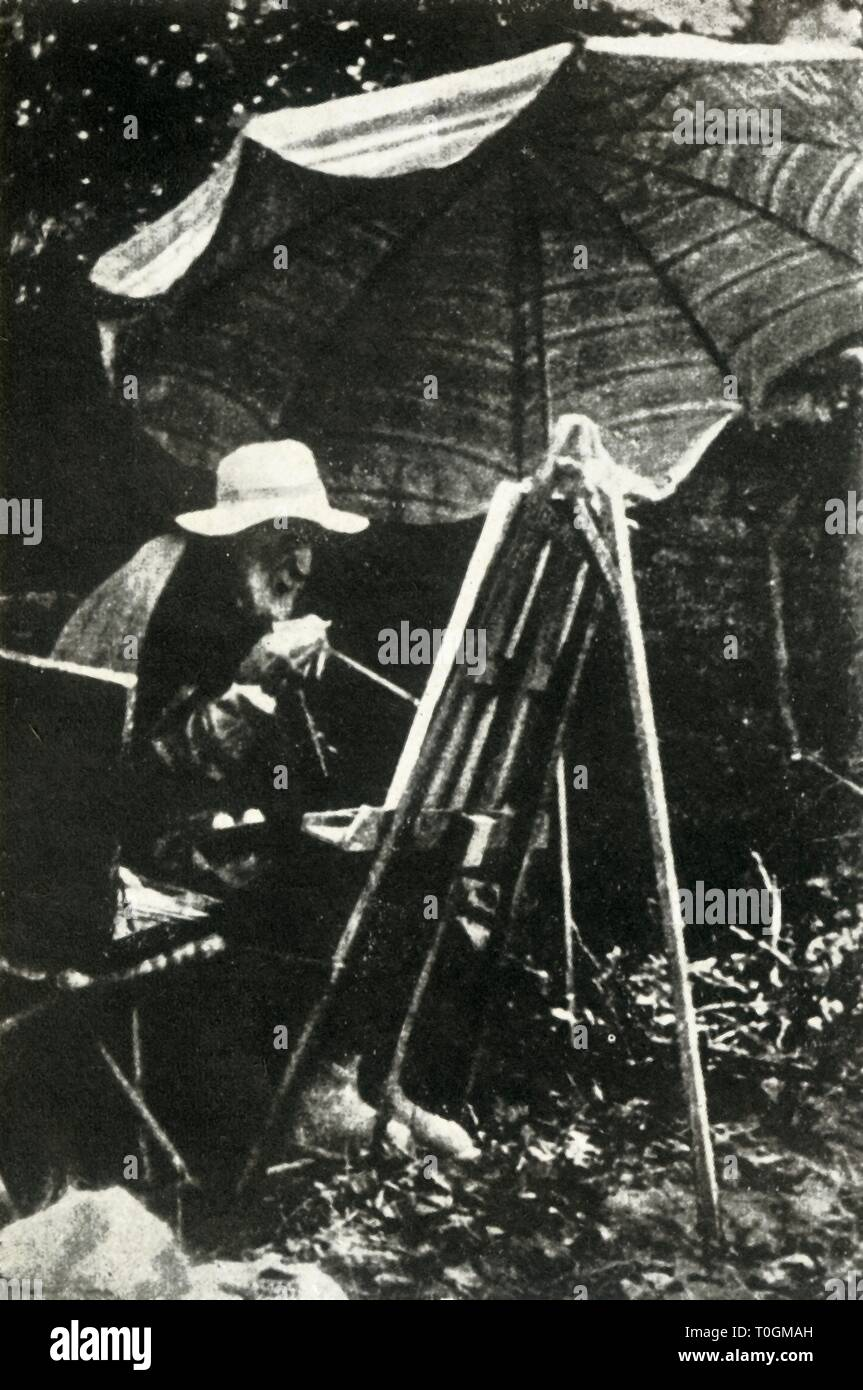 """Renoir painting outdoors, c1910s, (1947). The French painter Pierre-Auguste Renoir (1841-1919) at his easel under a parasol. Renoir painted till the end of his life, here he is using a brush tied to his arthritic hand. From """"The Saturday Book"""", Seventh Year, edited by Leonard Russell. [Hutchinson, St. Albans, 1947] - Stock Image"""