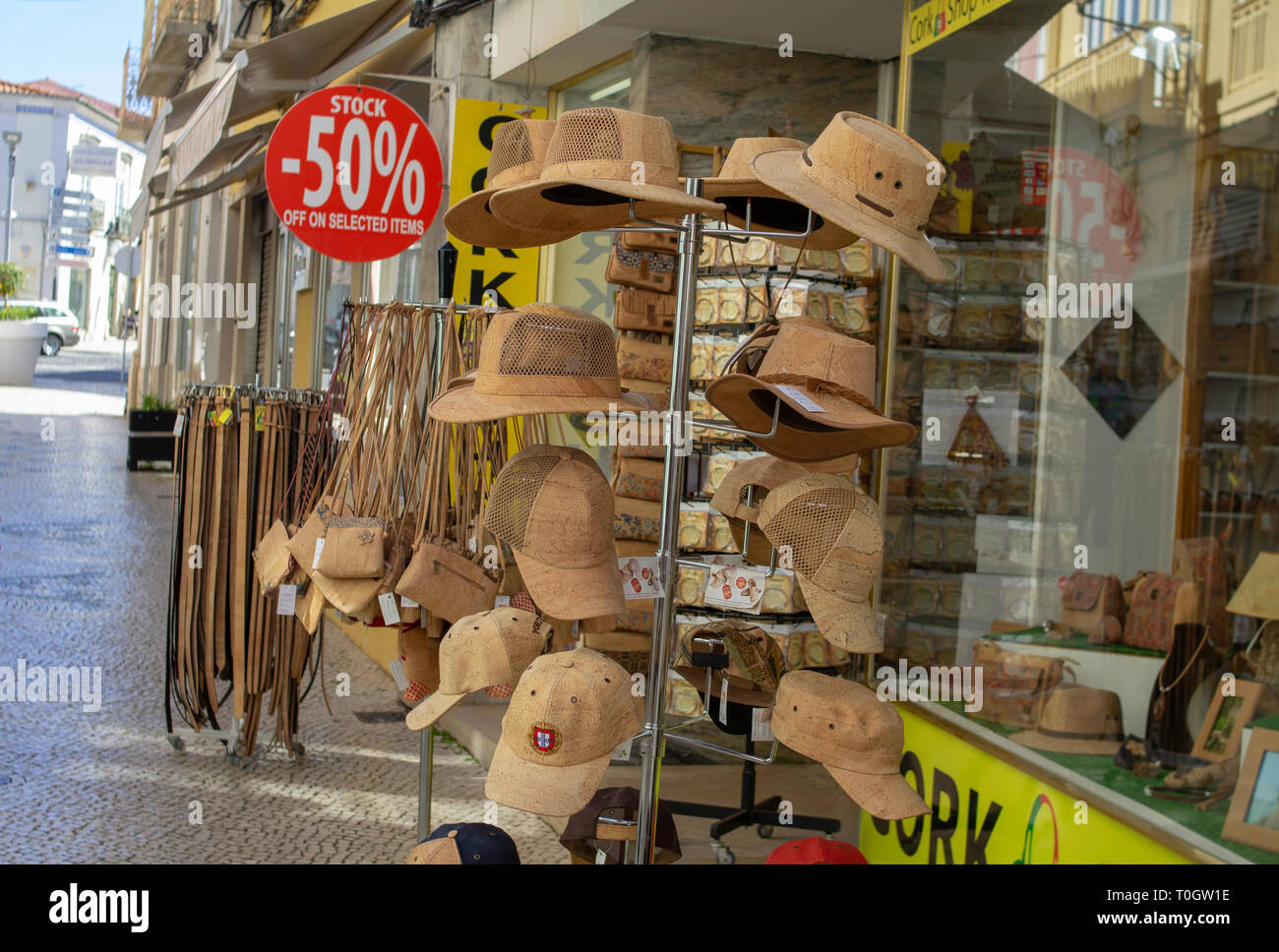 Headgear, hats,bags and belts made from cork outside a shop in Loulé, Portugal - Stock Image