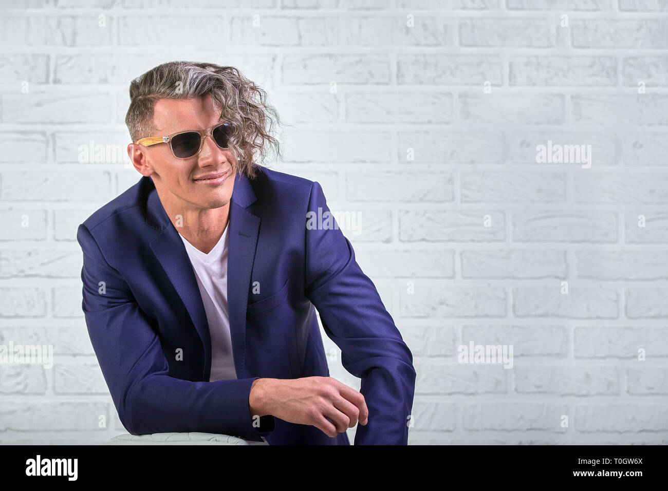 Fantastic Stylish Businessman With Curly Long Hair In Sunglasses Caraccident5 Cool Chair Designs And Ideas Caraccident5Info